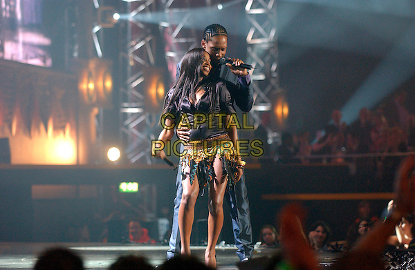 LEMAR & JAMELIA.Brit Awards 2005.Earls Court 2, London, SW5.February 9th, 2005.full length stage microphone singing music skirt arm around waist dancing.www.capitalpictures.com.sales@capitalpictures.com.©Capital Pictures