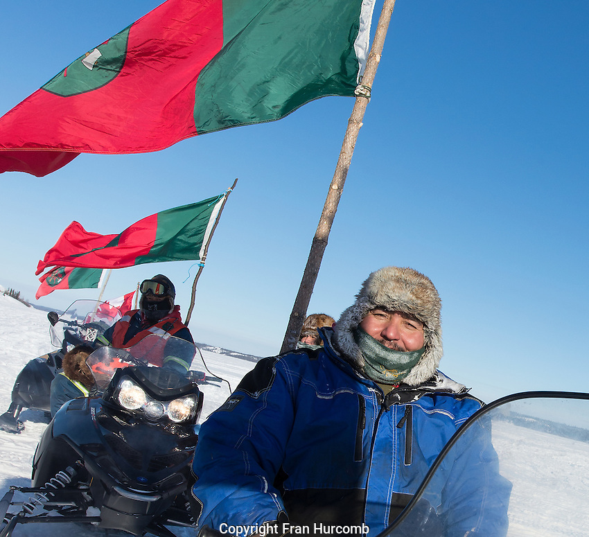 Ranger on snowmobile with flag