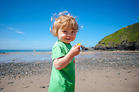 Friday  13  June  2014<br /> <br /> Pictured: A small young child stands on the beach at LLangrannog, Wales UK <br /> Re: Views of Llangrannog, Ceredigion, Wales UK
