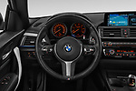 Car pictures of steering wheel view of a 2018 BMW 1 Series M Sport Ultimate 3 Door Hatchback