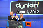 Nigel Travis & John Costello joins Dunkin Donuts to celebrate 'National Donut Day' as well as unveiling their new Electronic Billboard in Times Square, New York on 6/1/2012© Walter McBride .