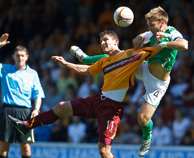 Chris Hogg rises above John Sutton to battle for the ball
