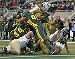 Wake Forrest running back Fabian Davis, 21, tries to hurdle the Oregon defensive line at fourth and goal, but is stopped short by Junior Slavii, 94, and Igor Olshanasky, 53, in the first half on  Monday, Dec. 30, 2002 at the Seattle Bowl. (AP Photo/Jim Bryant)