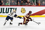 ST PAUL, MN - APRIL 7: Kobe Roth #10 of the Minnesota-Duluth Bulldogs skates past Jake Evans #18 of the Notre Dame Fighting Irish during the Division I Men's Ice Hockey Semifinals held at the Xcel Energy Center on April 7, 2018 in St Paul, Minnesota. (Photo by Carlos Gonzalez/NCAA Photos via Getty Images)