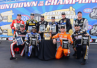 Sept. 14, 2012; Concord, NC, USA: NHRA top fuel dragster drivers (front row from left) Steve Torrence , Antron Brown , Spencer Massey , Tony Schumacher (back row from left) Doug Kalitta , Morgan Lucas , Shawn Langdon , Brandon Bernstein , David Grubnic and Bob Vandergriff Jr pose for a group shot with the championship trophy during qualifying for the O'Reilly Auto Parts Nationals at zMax Dragway. Mandatory Credit: Mark J. Rebilas-