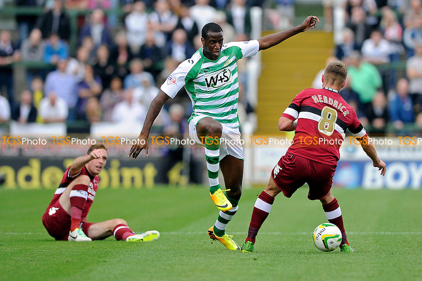 Michael Ngoo of Yeovil Town puts the ball between the legs of Jeff Hendrick of Derby County - Yeovil Town vs Derby County - Sky Bet Championship Football at Huish Park, Yeovil, Somerset - 24/08/13 - MANDATORY CREDIT: Denis Murphy/TGSPHOTO - Self billing applies where appropriate - 0845 094 6026 - contact@tgsphoto.co.uk - NO UNPAID USE