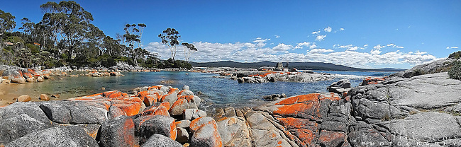 Panorama of the rocky foreshore in Binalong Bay in the Bay of Fires Conservation Area on the east coast of Tasmania in Australia