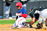8 March 2010: Washington Nationals' utilityman Willie Harris is out at the plate during a Spring Training game against the Florida Marlins at Space Coast Stadium in Viera, Florida. The Marlins defeated the Nationals 12-2 in Grapefruit League action. Mandatory Credit: Ed Wolfstein Photo