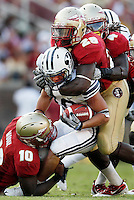 TALLAHASSEE, FL 9/18/10-FSU-BYU FB10 CH-Brigham Young's JJ Di Luigi is tackeled by Florida State's Nick Moody, left, Chris Finn and Terrance Parks during second half action Saturday at Doak Campbell Stadium in Tallahassee. The Seminoles beat the Cougars 34-10..COLIN HACKLEY PHOTO