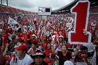 Supporters of Yingluck Shinawatra, sister of ousted premier Thaksin Shinawatra display their number one as they gather for the last big pre-election rally of the Puea Thai (For Thais) party at a stadium in Bangkok July 1, 2011. Thailand holds a general election on July 3 that might  be a step on the road to stability after five years of political turbulence. But it could just as easily prolong the rcrisis, especially if there is no clear-cut winner.  REUTERS/Damir Sagolj (THAILAND)