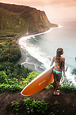 USA, Hawaii, The Big Island, paddle boarder scopes out the Waipio Valley surf conditions