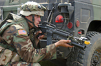 Fort Stewart, Ga., Sept. 25, 2006. - A U.S. Army Soldier from 1st Battalion, 41st Field Artillery Regiment, 1st Brigade, 3rd Infantry Division maintains a defensive position after a simulated attack during a mission readiness exercise at Fort Stewart, Ga., Sept. 25, 2006. (U.S. Army photo by Master Sgt. Johancharles Van Boers) (Released)