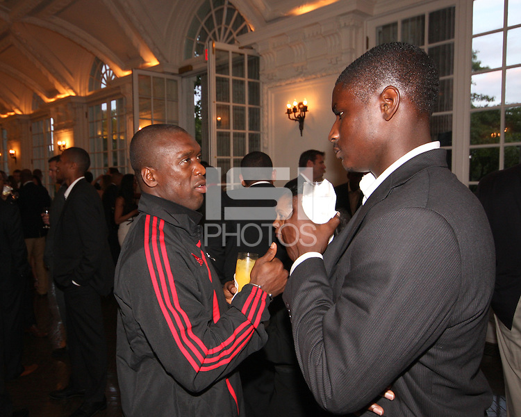 Clarence Seedorf of AC Milan talks to Bill Hamid of DC United at a reception for AC Milan at DAR Constitution Hall in Washington DC on May 24 2010.