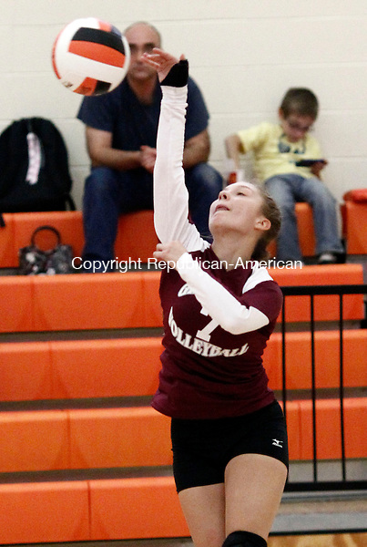 Terryville, CT- 03 October 2013-100313CM10-   Naugatuck's Kara Klimaszewski spikes the ball against Terryville during a volleyball matchup Thursday night in Terryville.  Christopher Massa Republican-American