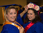 Lori Mills helps Patty Calvada with her hat before the TMCC Graduation held at Lawlor Events Center in Reno, Nevada on Friday, May 11, 2018.