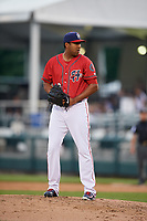 Harrisburg Senators relief pitcher Ronald Pena (20) gets ready to deliver a pitch during a game against the Akron RubberDucks on August 18, 2018 at FNB Field in Harrisburg, Pennsylvania.  Akron defeated Harrisburg 5-1.  (Mike Janes/Four Seam Images)