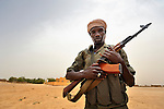 A Malian soldier on patrol in Toya, a village in northern Mali near Timbuktu. The region was seized by Islamist fighters in 2012 and then liberated by French and Malian soldiers in early 2013.