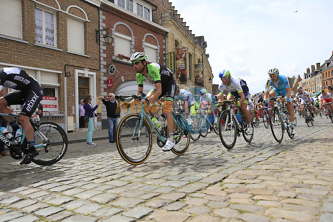 The peleton including Laurens Ten Dam (NED) Belkin pass through the ancient town of Cassel during Stage 4 of the 2014 Tour de France running 163.5km from Le Touquet to Lille. 8th July 2014.<br /> Picture: Eoin Clarke www.newsfile.ie