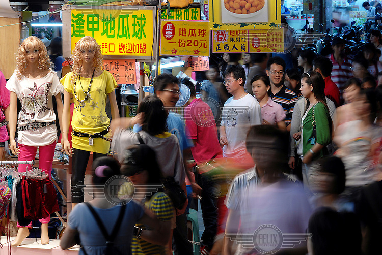Crowds and stalls at the Feng Chia Night Market in Taichung. Night Markets are a bustling and lively cultural element in Taiwanese life providing many attractions and distractions.