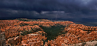 904000003 panoramic view of a violent summer monsoon thunderstorm produces lightning strikes and dark foreboding cloud formatoins over the hoodoos of the silent city in bryce canyon national park utah united states