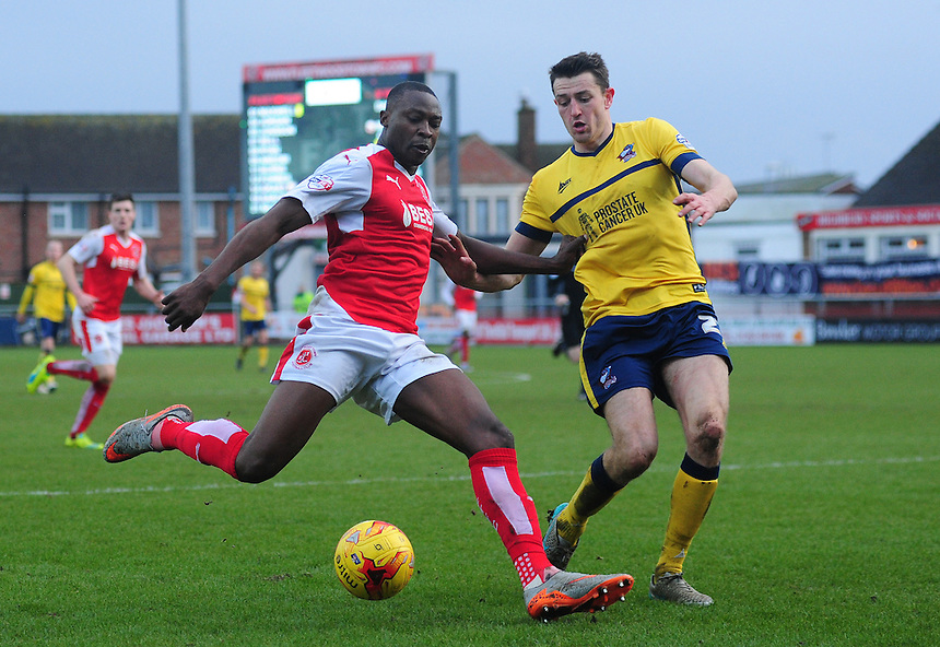 Fleetwood Town&rsquo;s Shola Ameobi vies for possession with Scunthorpe United&rsquo;s Murray Wallace<br /> <br /> Photographer Chris Vaughan/CameraSport<br /> <br /> Football - The Football League Sky Bet League One - Fleetwood Town v Scunthorpe United  - Saturday 20th February 2016 - Highbury Stadium - Fleetwood    <br /> <br /> &copy; CameraSport - 43 Linden Ave. Countesthorpe. Leicester. England. LE8 5PG - Tel: +44 (0) 116 277 4147 - admin@camerasport.com - www.camerasport.com