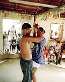 HONDURAS, Roatan, people watching a young couple dancing the Samba, Punta Gorda