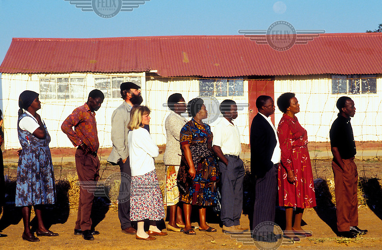 Voters queue at Shoshunguwe township, north of Pretoria on the day of the country's first democratic multiracial election.