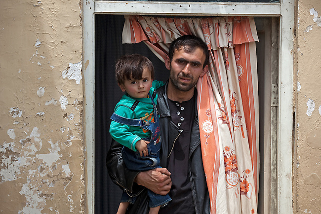 10 May 2012, Tajikhan Village, Jabalseraj District Parwan Province, Afghanistan : Abdul Basir with his two year old boy Elham at the Sar-e-Hause medical health clinic.  The clinic is funded by the Strengthening Health Activities for Rural Poor Project (SHARP). SHARP aims to improve the health and nutrition status of Afghans, focusing especially on women and children and the underserved areas of the country. Already remarkable progress has been made in the reduction of infant and under five mortality as well as pregnancy related mortality. With World Bank support in 11 provinces the number of health clinics has nearly tripled from 148 to 432 and about 85% of the population now lives in districts which now have service providers to deliver a basic package of health service.  The project supports Afghanistan's Health and Nutrition Sector Strategy  which is the governments blueprint for the health sector program for the period 2008-13. Picture by Graham Crouch/World Bank