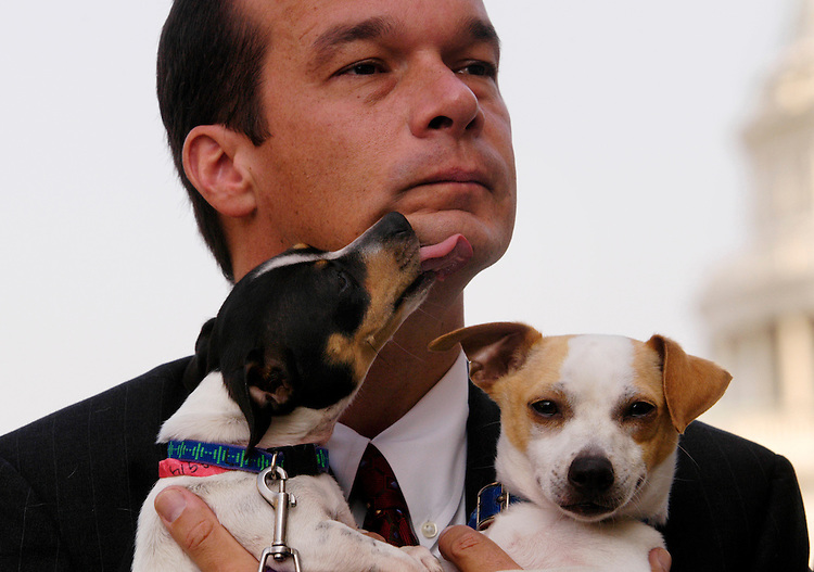 Howard Nelson, executive director of the DC Humane Society, holds recently rescued New Orleans dogs Frankie and Rosie at a press conference about the Pets Evacuation and Transportation Standards Act (PETS). The act, sponsored by Reps. Tom Lantos and Christopher Shays, would require local and state officials to include in evacuation plans household pets or service animals.
