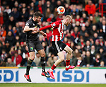 Grant Hanley of Norwich City and Oli McBurnie of Sheffield Utd during the Premier League match at Bramall Lane, Sheffield. Picture date: 7th March 2020. Picture credit should read: Simon Bellis/Sportimage