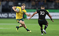 James O'Connor of the Wallabies runs at Richie Mo'unga of the All Blacks during the Rugby Championship match between Australia and New Zealand at Optus Stadium in Perth, Australia on August 10, 2019 . Photo: Gary Day / Frozen In Motion