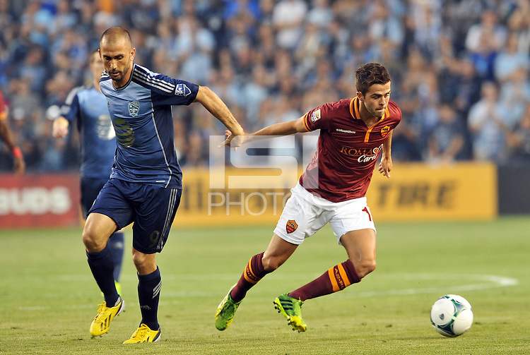 Sporting Park, Kansas City, Kansas, July 31 2013<br /> Miralem Pjanic (15) midfield AS Roma moves away from Marco Di Vaio.<br /> MLS All-Stars were defeated 3-1 by AS Roma at Sporting Park, Kansas City, KS in the 2013 AT & T All-Star game.