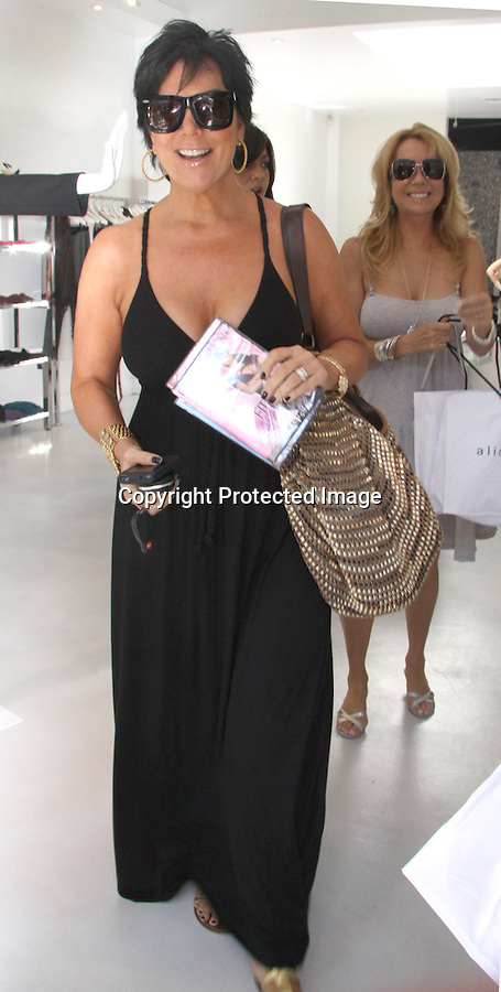 "8-24-09  ..Kris Jenner holding up the new Kim Kardasian ""Fit in your JEANS by FRIDAY"" dvd.  Kendall and Kylie Kardashian shopped inside with Kathie Lee Gifford & her daughter Cassidy at a store called Alice Olivia in Los Angeles .....AbilityFilms@yahoo.com.805-427-3519.www.AbilityFilms.com."
