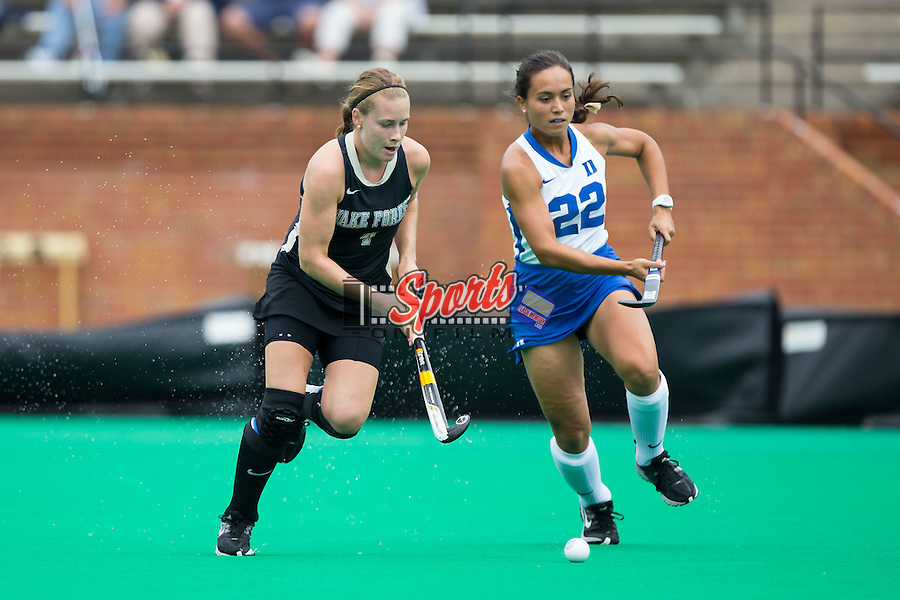 Christine Conroe (4) of the Wake Forest Demon Deacons tries to keep the ball away from Martine Chichizola (22) of the Duke Blue Devils at Kentner Stadium on September 14, 2014 in Winston-Salem, North Carolina.  The Demon Blue Devils defeated the Demon Deacons 2-1.  (Brian Westerholt/Sports On Film)