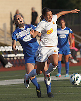 Painful contact. Boston Breakers defender Julie King (8) and Western New York Flash forward Samantha Kerr (4). In a National Women's Soccer League Elite (NWSL) match, the Boston Breakers (blue) tied Western New York Flash (white), 2-2, at Dilboy Stadium on June 5, 2013.