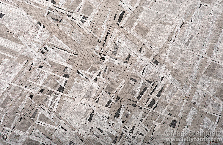 Close-up of the Widmanstätten pattern in an iron-nickel meteorite. These structures form in the slow cooling environment of outer space and are only found in meteorites--not in any terrestrial metals.