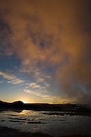 The sunset-colored steam cloud of the Excelsior Geyser Crater in Yellowstone National Park, Monday, May 30, 2005. (Kevin Moloney for the New York Times)