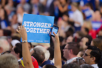 Supporter holds Stronger Together sign at Hillary Clinton and Al Gore Rally in Miami, FL on October 11, 2016