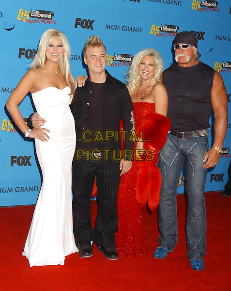 BROOKE, NICK, LINDA & HULK HOGAN.2005 Billboard Music Awards held at the MGM Grand Hotel & Casino, Las Vegas, Nevada..December 6th, 2005.Photo: Laura Farr/AdMedia/Capital Pictures.full length white strapless dress black trousers red jeans denim.www.capitalpictures.com.sales@capitalpictures.com.© Capital Pictures.