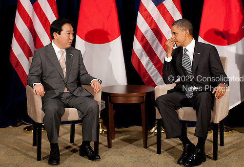 United States President Barack Obama, right, meets with Prime Minister Yoshihiko Noda of Japan, left, during the Asia-Pacific Economic Cooperation (APEC) at the Hale Koa Hotel  in Honolulu, Hawaii on Saturday, November 12, 2011..Credit: Kent Nishimura / Pool via CNP