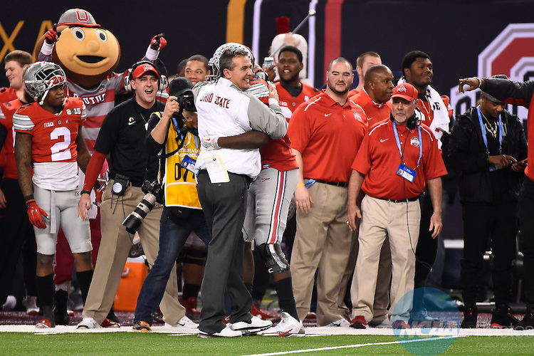 12 JAN 2015:  Head Coach Urban Meyer and Cardale Jones (12) of the Ohio State University celebrate their victory against the University of Oregon during the College Football Playoff National Championship held at AT&T Stadium in Arlington, TX.  Ohio State defeated Oregon 42-20 for the national title.  Jamie Schwaberow/NCAA Photos