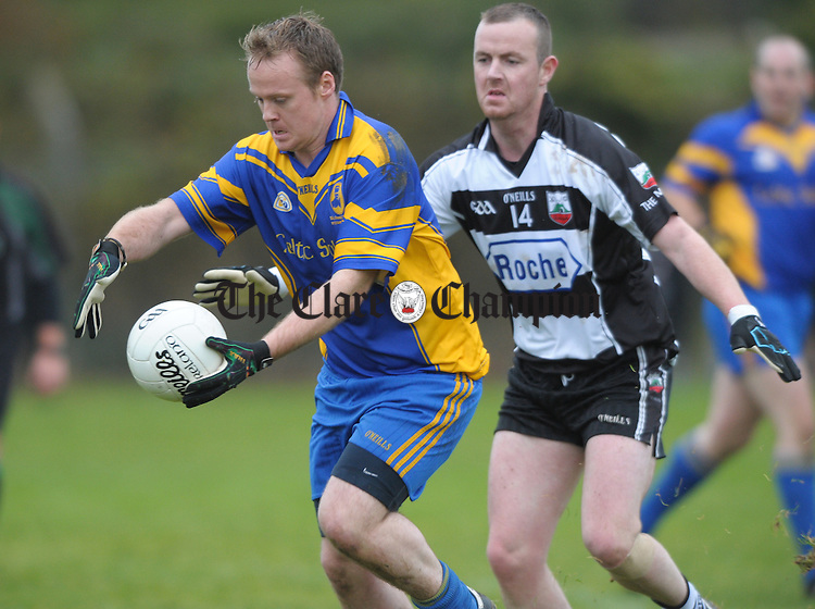 Colm Davoren of Michael Cusack's in action against Alan Considine of Clarecastle during their Junior A football final at Corofin. Photograph by John Kelly.