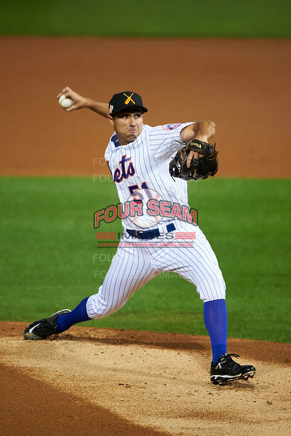 Salt River Rafters pitcher Mickey Jannis (51) delivers a pitch during an Arizona Fall League game against the Glendale Desert Dogs on October 22, 2015 at Salt River Fields at Talking Stick in Scottsdale, Arizona.  Glendale defeated Salt River 7-5.  (Mike Janes/Four Seam Images)