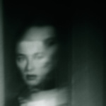 double image of a woman's face in a window