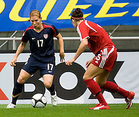 USWNT defender (17) Lori Chalupny tries to move past Canada's (15) Kara Lang during the finals of the Peace Queen Cup.  The USWNT defeated Canada, 1-0, at Suwon World Cup Stadium in Suwon, South Korea.