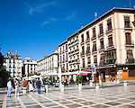 People and buildings in Plaza Neuva, Granada, Spain