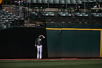 OAKLAND, CA - SEPTEMBER 8:  Cory Gearrin #61 of the Oakland Athletics stretches in the left field corner during the game against the Texas Rangers at the Oakland Coliseum on Saturday, September 8, 2018 in Oakland, California. (Photo by Brad Mangin)