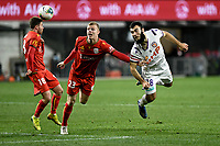 30th July 2020; Bankwest Stadium, Parramatta, New South Wales, Australia; A League Football, Adelaide United versus Perth Glory; Lachlan Brook of Adelaide United dives in to head the ball as Jordan Elsey of Adelaide United and Nicholas D'Agostino of Perth Glory challenge