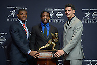 New York, NY - December 13, 2014: Heisman Trophy finalists (L-R) Amari Cooper (Alabama), Melvin Gordon (Wisconsin), and Marcus Mariota (Oregon) pose with the Heisman Memorial Trophy at the New York Marriott Marquis before the announcement of the winner.  (Photo by Greg Phillips/Media Images International)