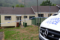 Pictured: A general view of the house where the body of David Gaut was discovered in New Tredegar, Wales, UK. Wednesday 08 August 2018<br /> Re: Three men have been arrested after a man was found dead at a house in New Tredegar, Wales, UK.<br /> David Gaut, 54, was found in Long Row, in the Elliots Town area of New Tredegar, on Saturday, August 4.<br /> Two two-storey terraced homes, owned by Caerphilly council, have been cordoned off and police officers are patrolling the area. <br /> David Gaut was jailed for life in July 1985 when he was 21 years old, for the murder and torture of17-month old Chi Ming Shek